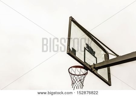 Street basketball board on a background of bright sky
