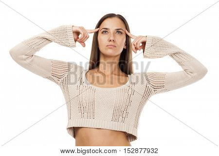 A young brunette woman with a headache holding head, isolated on white background