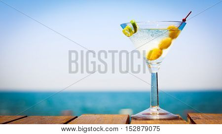 Glass Of Martini Bianco At The Wooden Pier. Concept Of Summer Vacation. Popular Cocktail By The Sea.