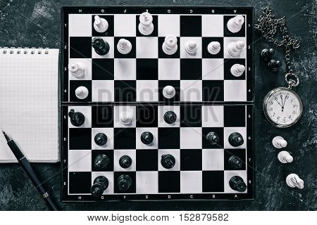 Chess pieces in the battle positions on the board. Flat lay
