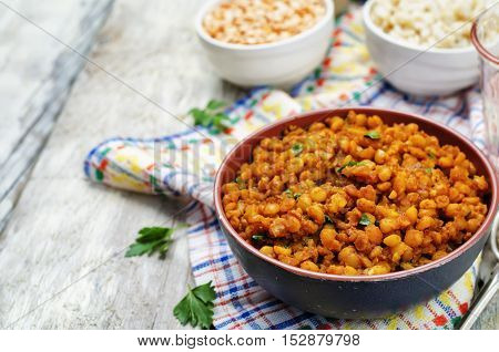 Delicious and healthy split peas dal on wood background