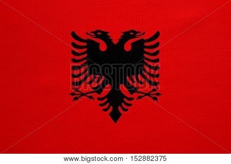 Albanian national official flag. Patriotic symbol banner element background. Correct colors. Flag of Albania with real detailed fabric texture accurate size illustration