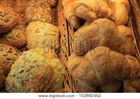 Assorment of baked bread on display in a bakery
