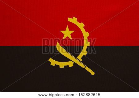 Angolan national official flag. African patriotic symbol banner element background. Correct colors. Flag of Angola with real detailed fabric texture accurate size illustration