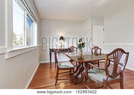 Dining Room Interior With Carved Wooden Furniture