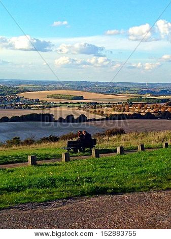people sitting on a bench taking in the view - Dunstable Downs Bedfordshire England