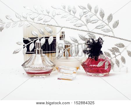 Jewelry table with lot of girl stuff on it, little mess in cosmetic brushes, women interior concept, perfume elegance things close up