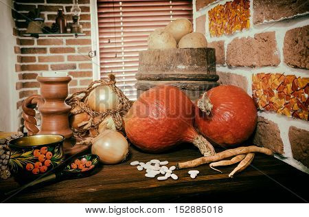 still life with pumpkin honey and vegetable farming selective focus