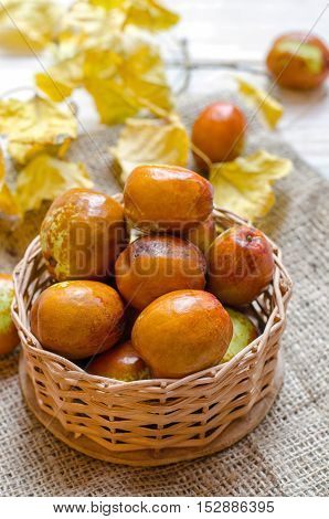 Fresh jujube or chinese date in a small basket.