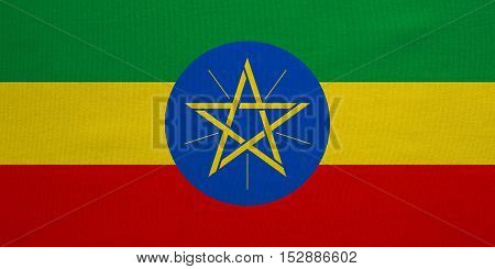 Ethiopian national official flag. African patriotic symbol banner element background. Correct colors. Flag of Ethiopia with real detailed fabric texture accurate size illustration