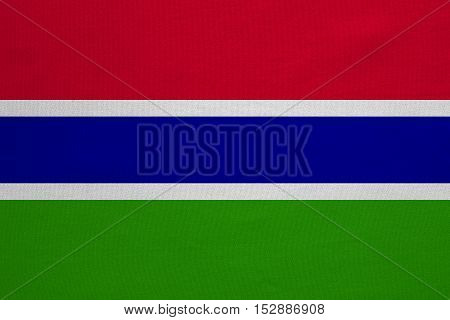 Gambian national official flag. African patriotic symbol banner element background. Correct colors. Flag of the Gambia with real detailed fabric texture accurate size illustration