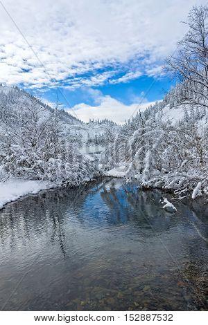 Beautiful lake Amut in taiga hills on Far East of Russia in early october. Mountain lake in winter. Beautiful nature.