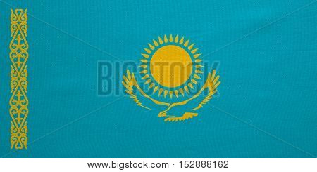 Kazakhstani national official flag. Patriotic symbol banner element background. Correct colors. Flag of Kazakhstan with real detailed fabric texture accurate size illustration