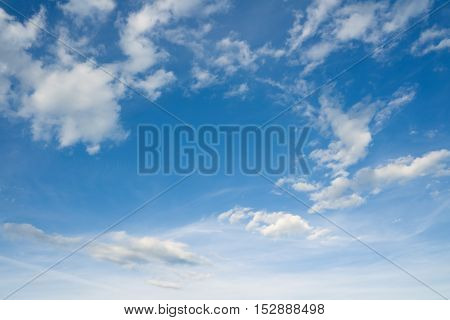 Blue sky and clouds over horizon. White clouds in the blue sky.