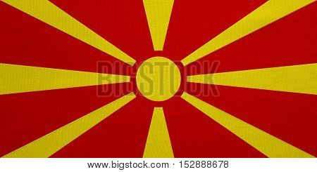 Macedonian national official flag. Patriotic symbol banner element background. Correct colors. Flag of Macedonia with real detailed fabric texture accurate size illustration