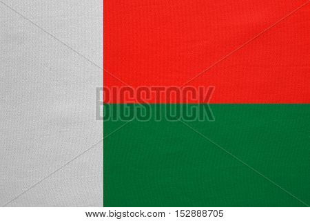 Madagascar national official flag. African patriotic symbol banner element background. Correct colors. Flag of Madagascar with real detailed fabric texture accurate size illustration