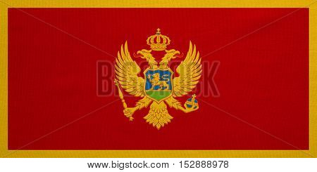 Montenegrin national official flag. Patriotic symbol banner element background. Correct colors. Flag of Montenegro with real detailed fabric texture accurate size illustration