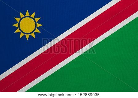Namibian national official flag. African patriotic symbol banner element background. Correct colors. Flag of Namibia with real detailed fabric texture accurate size illustration