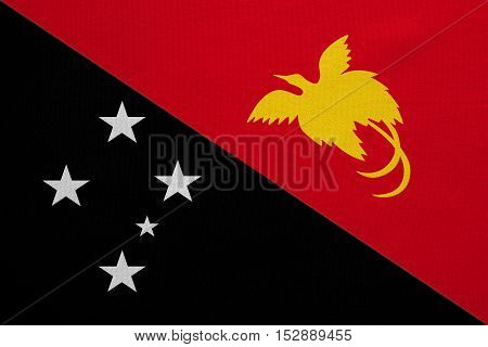 Papua New Guinean national official flag. Papuan patriotic symbol banner element background. Correct colors. Flag of Papua New Guinea with real detailed fabric texture accurate size illustration
