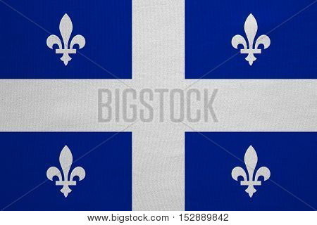 Canadian provincial flag QC patriotic element and official symbol. Canada Quebec banner and background. Flag of the Canadian province of Quebec real fabric texture accurate size color illustration