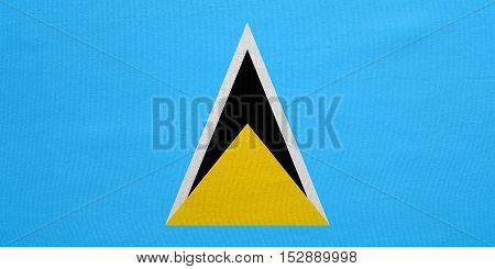 Saint Lucian national official flag. Patriotic symbol banner element background. Correct colors. Flag of Saint Lucia with real detailed fabric texture accurate size illustration
