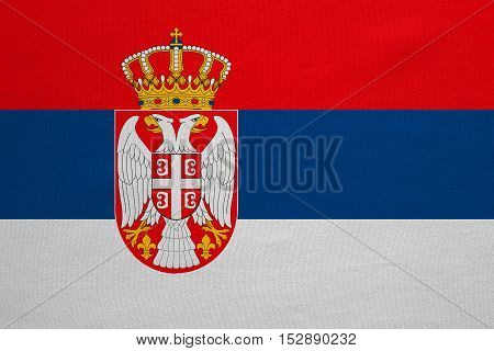 Serbian national official flag. Patriotic symbol banner element background. Correct colors. Flag of Serbia with real detailed fabric texture accurate size illustration
