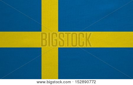 Swedish national official flag. Patriotic symbol banner element background. Correct colors. Flag of Sweden with real detailed fabric texture accurate size illustration