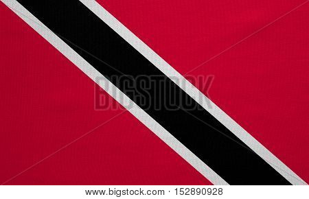 Trinidadian and Tobagonian national official flag. Patriotic symbol banner element background. Correct colors. Flag of Trinidad and Tobago real detailed fabric texture accurate size illustration