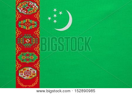 Turkmen national official flag. Patriotic symbol banner element background. Correct colors. Flag of Turkmenistan with real detailed fabric texture accurate size illustration