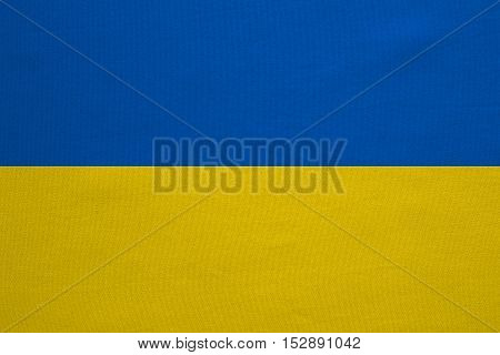 Ukrainian national official flag. Patriotic symbol banner element background. Correct colors. Flag of Ukraine with real detailed fabric texture accurate size illustration