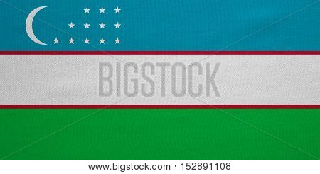 Uzbek national official flag. Patriotic symbol banner element background. Correct colors. Flag of Uzbekistan with real detailed fabric texture accurate size illustration