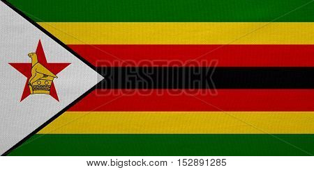 Zimbabwean national official flag. African patriotic symbol banner element background. Correct colors. Flag of Zimbabwe with real detailed fabric texture accurate size illustration