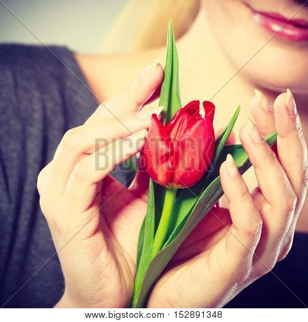 Smiling Woman Embracing Flower.