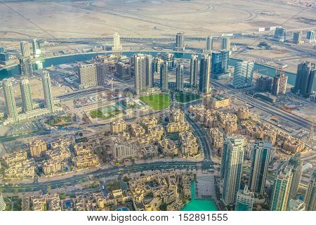 Aerial view of Burj Khalifa Lake area and skyscrapers in Dubai downtown, United Arab Emirates, from top.