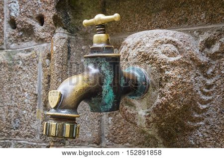 Old Faucet On Concrete Wall.