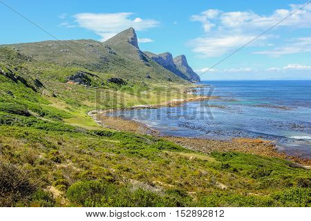 Beautiful beach on the east coast in Cape of Good Hope Nature Reserve, False Bay, Cape Peninsula, the section of the Table Mountain National Park. Western Cape, South Africa.