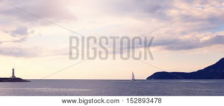 Sailing Boat And Lighthouse