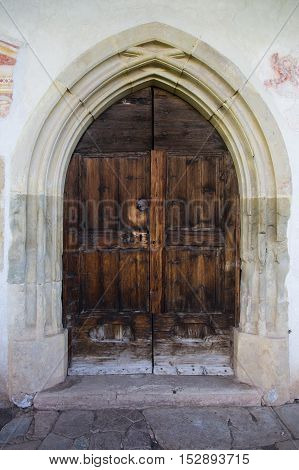 Front view of a wooden door of a church
