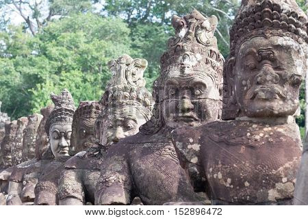 Demon or Asuras ( in Sanskrit) row at entrance of Angkor Thom,Siem Reap, Cambodia.