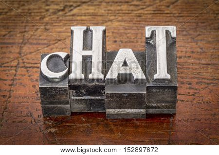 chat word abstract in vintage letterpress metal type against weathered wood