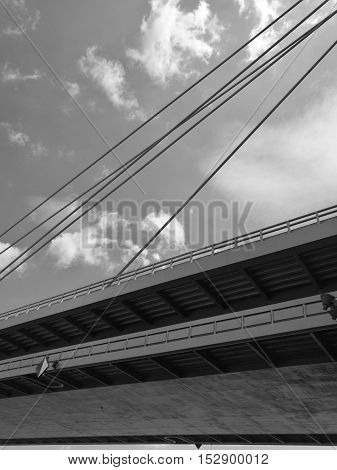 Low angle monochrome view of Danube Bridge against sky and clouds in Bratislava