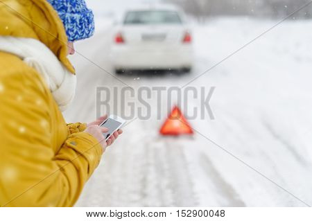 Woman in winter calls to the emergency services