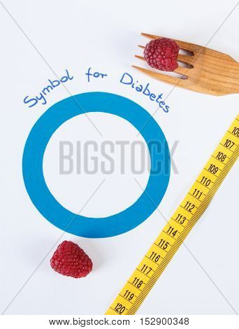 Symbol Of World Diabetes Day And Fresh Raspberries With Centimeter