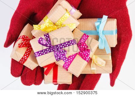 Hands Of Woman In Gloves With Gifts For Christmas Or Other Celebration