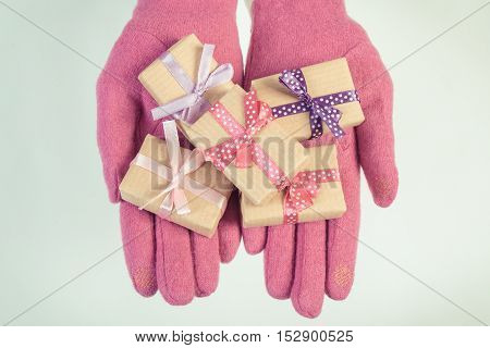Vintage Photo, Hands Of Woman In Gloves With Gifts For Christmas Or Other Celebration