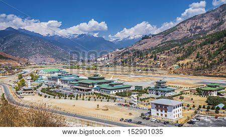 mountain landscape with village and mini building airport, Paro, Bhutan