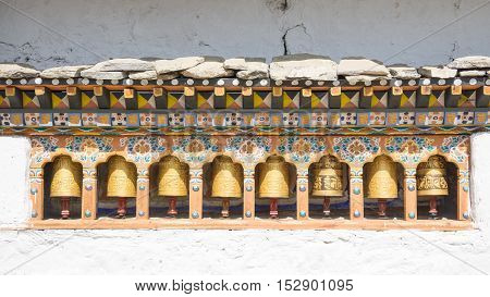The religious prayer wheels in Bhutan .