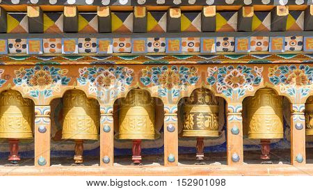 The religious prayer wheels in Bhutan .