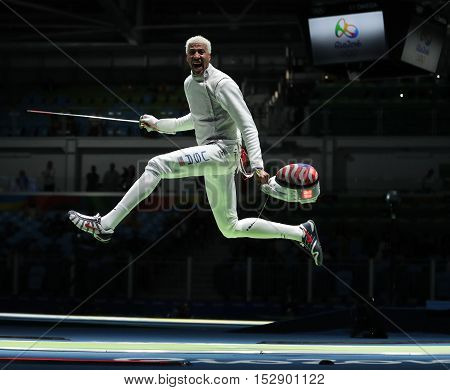 RIO DE JANEIRO, BRAZIL - AUGUST 12, 2016: Fencer Miles Chamley-Watson of United States competes in the Men's team foil of the Rio 2016 Olympic Games at the Carioca Arena 3