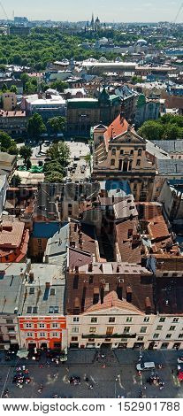 Old city vintage panorama with houses roofs top view Lviv Ukraine.